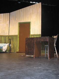 Wallpaper on set piece was distressed in order to give the orphanage a run-down appearance. Miss Hannigan's desk on stage.