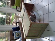 Old door turned coffee table. Perfect for our new screened in porch :)