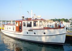 Vintage Tugboat, Restless at Put-in-Bay, Ohio. Available for sunset cruises on Lake Erie. Visit www.putinbaycruises.com