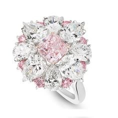 """Asprey. The Tudor Rose Ring - Inspired by the heraldic floral emblem of England since the reign of Henry VII, the Tudor Rose features a breathtakingly rare purple-pink diamond in the centre encircled with pear shaped diamonds to create the petals of the rose and finally bordered with smaller pink diamonds to complete the look of the bicoloured """"Tudor Rose""""."""