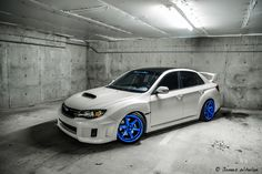 Subaru Impreza WRX STi on Blue wheels