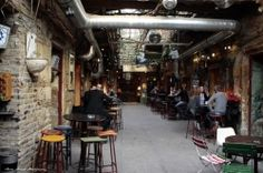 """BUDAPEST: Szimpla Kert, one of the many """"Ruin Pubs"""" of Pest, """"The recipe is simple: search for an old building in downtown Pest, rent the cellar and the ground floor, do not renovate anything, invite some contemporary artists and designers, recreate the atmosphere of the 70's, build a bar and serve some drinks, invite a band and be open until the morning comes."""""""