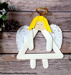 Angel Christmas Ornament Keepsake Materials: Jumbo craft sticks Glue Heart doily White craft paint and brush Misc. skin tone and hair colored colored card stock Scissors Gold Chenille stem Child photo Black pen/ extra fine sharpie String or magnet Directions: Paint 5 jumbo craft sticks white and let dry Glue 3 craft sticks together forming a triangle shape Cut 2 ends off of 2 craft sticks (making the hands and feet) Glue 2 of your ends to the sides of the top half of your triangle and tr...