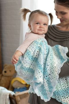 Lacy shells blanket. Calls for Red Heart Sweet Baby self-striping yarn.
