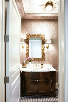 A metallic cork wallpaper by Thibaut lines the powder room which also features a Christopher Guy mirror Urban Electric. Guest Bathrooms, Hall Bathroom, Bathroom Ideas, Bathroom Modern, Cork Wallpaper, Bathroom Wallpaper, Bath Paint, Luxury Lighting, Architectural Digest