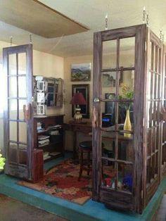 Love the old doors hanging as room deviders