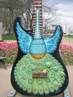 This would make me want to learn guitar. Rock N Roll Hall Of Fame Guitar Fender, Guitar Art, Music Guitar, Cool Guitar, Playing Guitar, Guitar Tattoo, Guitar Painting, Peacock Decor, Peacock Art