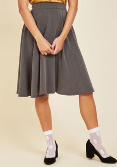 <p>You hear your friend's truck horn outside your window - your trumpet call to scoot this A-line skirt out the door and hop in! Boasting a high waistline, this classic grey bottom looks blissful against every panorama you pass.</p>