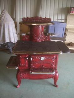 Red Antique Wood burning cook Stove.