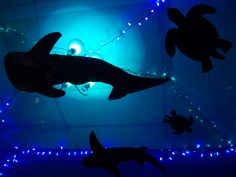 The Under The Ocean birthday party theme I did for my daughter. We used blue celophane on the ceilings and cut out huge black shadows of sea animals so you looked like you were under the ocean :)