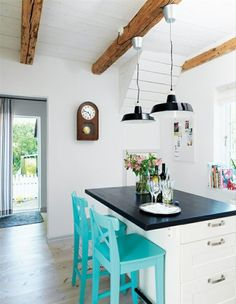 White backdrop with rustic beams across the ceiling and a pop of teal give this room a clean look - Read the Blog at: http://www.aesthetedesigns.com/blog/ Aesthete Designs - Become a fan at:goo.gl/U6zPw
