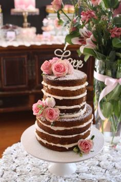 This unfrosted cake is the top tier. Would like pink sugar flowers on the side between the tiers. TOP TIER - 6 inch