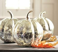 'Looking glass' spray can transform pumpkins into these gorgeous centerpieces! Use a white spray first to get the best effect. (Could do this to anything!)