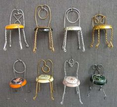 Tiny chairs made from Champagne cork wire..... want to make chairs and little tables and put a few on bar and buffet line/dessert table.. !!! :)