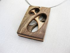 Modernist pendant necklace made of exotic wood.