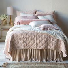 """Rich with texture, the romantic Bella Notte Marseille collection showcases inspired French-country flair. This coverlet's timeless quilted pattern of lattice embroidery presents enduring charm to bedding ensembles. Feminine and vintage-inspired, this cotton velvet layer boasts limitless refinement. King: 114""""W x 95""""L. Queen: 94""""W x 95""""L. Available in several colors. 100% Cotton. Quilted. Backed in trecento. Satin edges."""