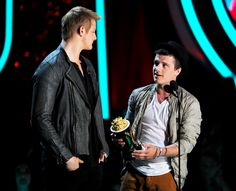 Alexander Ludwig and Josh Hutcherson accept the award for Best Fight at the MTVMovieAwards Sunday night in Universal Studios, Los Angeles.