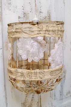 Rusty birdcage hanging lamp swag lace doilies distressed French tea stained muslin ribbon Edison style light bulb Anita Spero. $170.00, via Etsy.