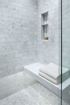 """Homepolish Interior Design   For the shower walls, Guinevere """"chose not to offset the Carrara tile, but to lay it out in a grid. This made it much more urban and contemporary and befits the downtown loft. I literally laid out each piece of tile myself, with the help of Alex. We created a painting out of the movement in the Carrara. It was harder but worth it!"""""""