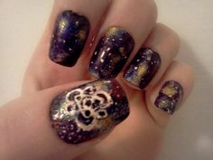 Coheed and Cambria nails.  If I was mildly good at painting my nails, I would do this in a heartbeat!