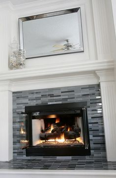 Updated fireplace. Grey & black glass tile. #decor #tile #fireplace