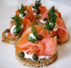 Smoked Salmon Canapes Perfectly portioned, these easy to make canapés are layered with a whipped chive cream cheese, salmon and veggies. Brunch is served! Smoked Salmon Canapes, Cooking Recipes, Healthy Recipes, Snacks, Appetisers, Appetizer Recipes, Canapes Recipes, Brunch Recipes, Food Porn