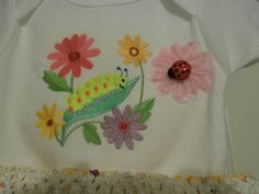 Close up of the embroidery on the springtime onesie.