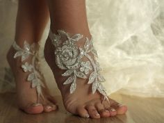 So intricate and pretty. ivory Beach wedding barefoot sandals by Weddngstore on Etsy, $30.00