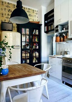 vintage meets modern, love that classic refrigerator and well-loved kitchen table
