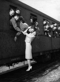 17 year-old girl from Berlin as she gives a farewell to her boyfriend, a member of the King's Own Scottish Borderers at the Spandau-West station; 1963.