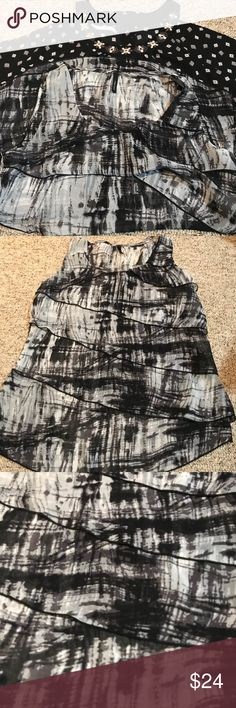 2 Maurices sleeveless tops black and gray Bundle of two Maurices tops.  Sleeveless and sheer.   Fast shipper, 4.9 rating, Posh Ambassador  50% off bundles of three or more items!!  New to Poshmark? Use my code AMT1111 for a $5 discount! Maurices Tops