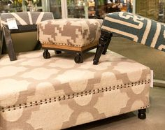 Surya's new line of accent furniture has great details like nail head trim, caster feet, metal bases, and wood turned legs.