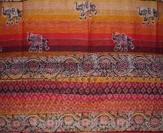 Price: $21.99  Beautiful tab top panel made of 100% hand-woven quality cotton. Panel measures 44 X 88 inches. Alternating floral printed and plain stripes with little detailed elephants geometrically placed. The dominant color is a bright sunny orange with touches of cranberry, splashes of tangerine and gold. http://www.fullmoonloom.com/p-319-tab-top-curtain-panel-little-elephants-orange.aspx