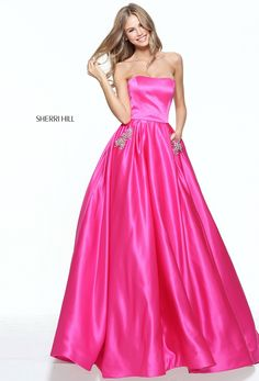 There's no fairy godmother required for Sherri Hill 50812. Feel like a true princess in this strapless satin ball gown. The fitted bodice adds a beautiful contrast to the full, floor-length skirt with hidden bejeweled pockets at the hips. This look is perfect for prom, a military ball, a charity ball, or anywhere you might find Prince Charming.   var _currentScript = document.currentScript || null; (function () { var script = document.createElement('script'); script.type…
