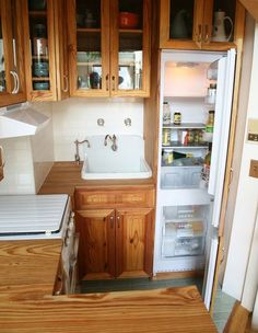 What a darling tiny kitchen! - This 40 square foot kitchen includes storage, prep space, cooking space and a washer-dryer! Tiny House Cabin, Tiny House Living, Tiny House Plans, Living Room, Home Design, Tiny House Design, Design Ideas, Simple Kitchen Design, Kitchen Designs