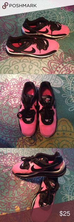 Pink and black Nike air maxes pink and black Nike air maxes. only word a few times. in excellent condition. super cute and super comfy ! Nike Shoes Athletic Shoes