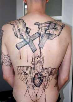 cross-in-hand-and-human-heart-tattoo-on-back.jpg (450×625)