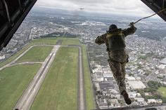 Soldiers assigned to the 1st Special Forces Group (Airborne) conduct a jump…
