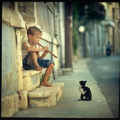 I love how the picture looks really natural. I like how the background is blurred to make the boy and the cat stand out a lot.