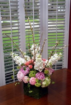 Pussy willows and coral charm peonies say springtime.