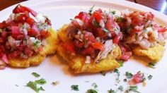 Cuban meets Mexican: From left, tostones topped with pico de gallo and ground beef, pork and shrimp YUM!!!
