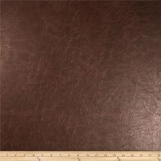 """Richloom Faux Leather Distressed Schwimmer Saddle from @fabricdotcom  This upholstery weight faux leather fabric has a soft flannel backing and can be used for upholstery projects, picture frames, pillows, headboards craft projects, purses, fashion accessories and more!  California residents click <a href=""""http://prop65.fabric.com/"""">here</a> for Proposition 65 information."""