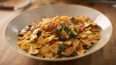Farfalle with mozzarella and tomato sauce. With step by step pasta making instructions.From Michela Chiappa on Simply Italian, Channel 4. I love this programme!