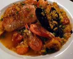 Chunky pieces of chicken, and whole prawns and mussels add to the intrigue of a home cooked paella.