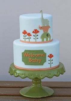 Baby Shower Cake with cutout zoo animals and flowers. Very simple style