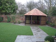 Garden House with paved path.  Stunning natural garden walls with mature planting.