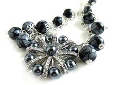 #Handmade Trends for Fashionistas!  Black and gray snow obsidian rounds wire wrapped to the sterling silver chain. The center is a new vintage style round brooch with silvery black crystal pearls and rhinesto... #sellertools #accessories #knit #crochet #felt #fashion #jewelry #necklace #stone #victorian #rusteam #wirewrapped #handmade #shabby