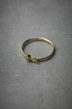my mom's wedding band is a band of gold leaves.   I've always loved it. I think this would be so cute with it.