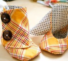 I need a sewing machine! Lol so cute.. maybe a different fabric though... DIY Baby Booties Pattern - Easy Peasy