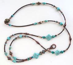 CJs Inspirations  Desert Southwest  This beautiful lanyard is made with Picture Jasper, Magnesite, Turquoise, and Australian Zebra Jasper Gemstones, sparkling crystals, mahogany pearls, and Tibetan silver spacers. What a stunning addition to your lanyard collection and a beautiful gift for others.  Features and Options:  Magnetic Clasp- Ideal for those that prefer a clasp or may have children pull on them, or for those that tend to catch their lanyards on things at work. These are designed…